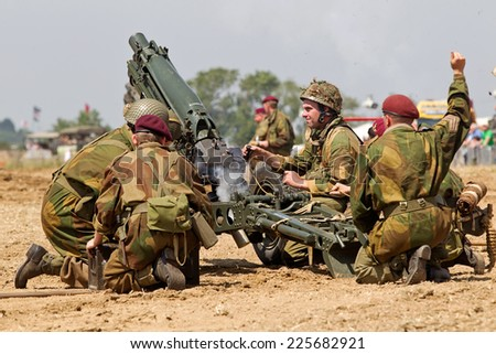 WESTERNHANGER, UK - JULY 18: Members of a Living History group fire their artillery pieces in the arena to mark the passing of the midday gun at the War & Peace show on July 18, 2014 in Westernhanger - stock photo