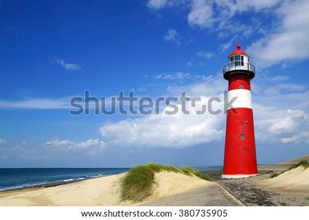 WESTKAPELLE, HOLLAND - AUGUST 01, 2012: Westkapelle Lighthouse. Westkapelle lighthouse was built in 1875 of cast iron, is has a visibility range of 13 nautical miles;