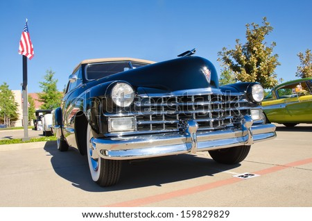 WESTLAKE, TEXAS - OCTOBER 19: A 1947 Cadillac Series 62 Convertible is on display at the 3rd Annual Westlake Classic Car Show on October 19, 2013 in Westlake, Texas. Front view. - stock photo