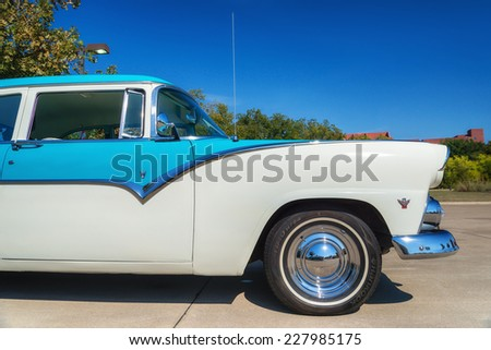 WESTLAKE, TEXAS - OCTOBER 18, 2014: A 1955 Ford Fairlane is on display at the 4th Annual Westlake Classic Car Show. Closeup of front side view. - stock photo