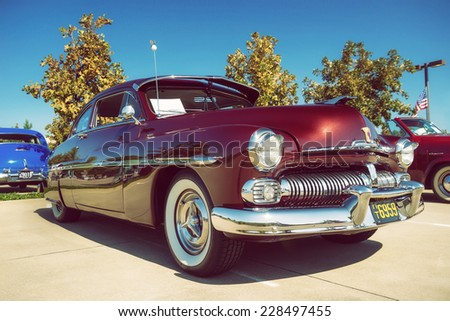 WESTLAKE, TEXAS - OCTOBER 18, 2014: A 1950 Mercury Coupe is on display at the 4th Annual Westlake Classic Car Show. Front side view. Vintage style effects.