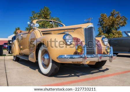 WESTLAKE, TEXAS - OCTOBER 18, 2014: A 1941 Packard 120 (One-Twenty) Convertible Sedan is on display at the 4th Annual Westlake Classic Car Show. Front side view.  - stock photo