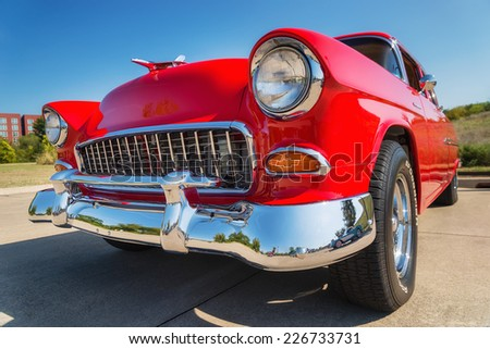 WESTLAKE, TEXAS - OCTOBER 18, 2014: A red 1955 Chevrolet 210 is on display at the 4th Annual Westlake Classic Car Show. Front view closeup. - stock photo
