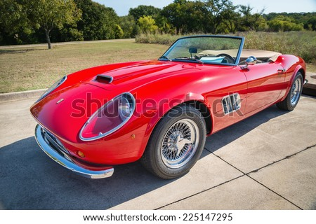 WESTLAKE, TEXAS - OCTOBER 18, 2014: A red 1962 Ferrari 250 GT California Spyder is on display at the 4th Annual Westlake Classic Car Show. Front side view. - stock photo