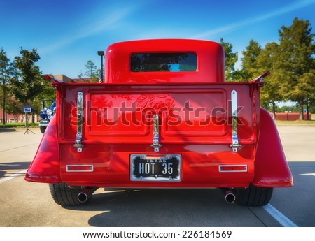 WESTLAKE, TEXAS - OCTOBER 18, 2014: A red 1935 Ford pickup truck is on display at the 4th Annual Westlake Classic Car Show. Rear view.  - stock photo