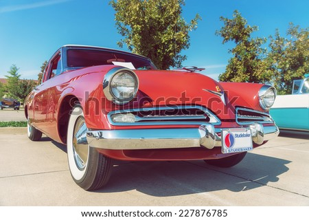 WESTLAKE, TEXAS - OCTOBER 18, 2014: A 1953 Studebaker Commander Coupe is on display at the 4th Annual Westlake Classic Car Show. Front view. Vintage style effects. - stock photo