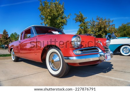 WESTLAKE, TEXAS - OCTOBER 18, 2014: A 1953 Studebaker Commander Coupe is on display at the 4th Annual Westlake Classic Car Show. Front side view. - stock photo