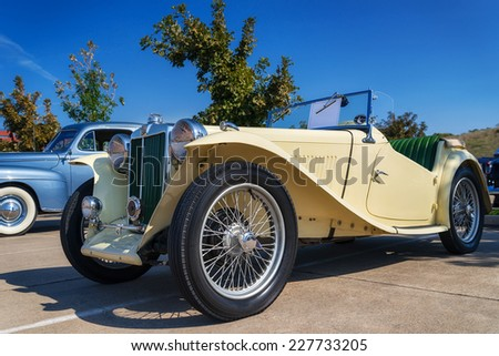 WESTLAKE, TEXAS - OCTOBER 18, 2014: A yellow 1947 MG TC Roadster is on display at the 4th Annual Westlake Classic Car Show. Front side view. - stock photo