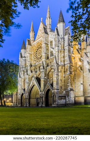 Westminster Abbey (The Collegiate Church of St Peter at Westminster) at night - Gothic church in City of Westminster, London. Westminster is traditional place of coronation for English monarchs. - stock photo