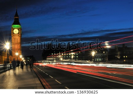 Westminster Bridge and Big Ben, London UK, at night, with light streaks and movement - stock photo