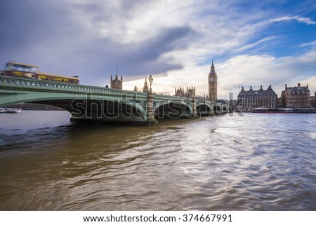 Westminster Bridge, Big Ben and Houses of Parliament with sightseeing bus at sunset - London, UK - stock photo