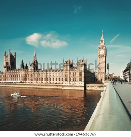 Westminster bridge in London with a view towards London Parlamend and Big Ben, square composition, tint - stock photo