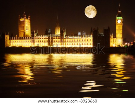 Westminster - houses of parliament reflected in the Thames at night - stock photo