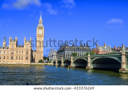 Westminster Palace and the Big Ben in London against blue sky - stock photo