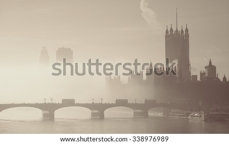 Westminster Palace in fog seen from Hungerford Bridge  - stock photo