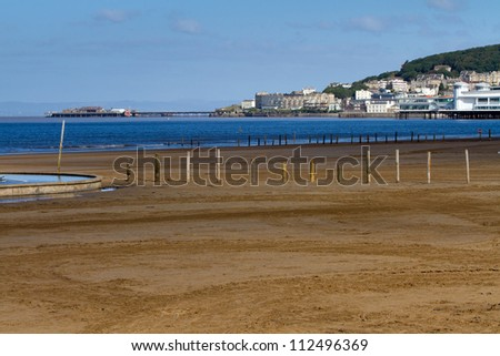 Weston-super-Mare beach with the Old Pier and Grand Pier in the background - stock photo