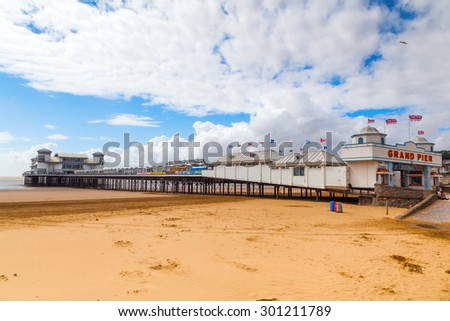 WESTON-SUPER-MARE - JULY 07, 2015: Grand Pier with unidentified people. The pier is a pleasure pier on the Bristol Channel, it has been damaged by fire 1930 and 2008. After 2008 fire new opened 2010