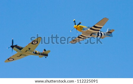 WESTON-SUPER-MARE, SOMERSET-JULY 24:  The Grand Pier Air Show in Weston-super-Mare on Tuesday 24th July 2012.  A Spitfire and a Mustang perform for the crowds - stock photo