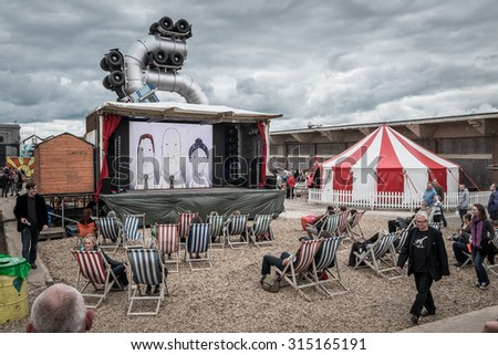 WESTON-SUPER-MARE, UK - SEPTEMBER 3 2015: Outdoor Cinema at Banksy's Dismaland Bemusement Park. A five week show in the seaside town of Weston-Super-Mare. - stock photo