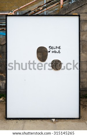WESTON-SUPER-MARE, UK - SEPTEMBER 3 2015: Selfie Hole at Banksy's Dismaland Bemusement Park. A five week show in the seaside town of Weston-Super-Mare. - stock photo