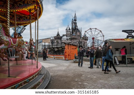 WESTON-SUPER-MARE, UK - SEPTEMBER 3 2015: The merry go round and castle at Banksy's Dismaland Bemusement Park. A five week show in the seaside town of Weston-Super-Mare. - stock photo