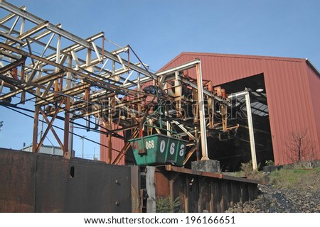 WESTPORT, NEW ZEALAND, CIRCA 2007: Buckets on the aerial ropeway carry coal down to the the railway terminal at Stockton Coal Mine, West Coast, South Island, New Zealand         - stock photo