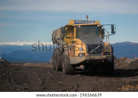 WESTPORT, NEW ZEALAND, CIRCA 2007: Coal truck on Mount Frederick at Stockton Coal Mine, West Coast, South Island, New Zealand       - stock photo