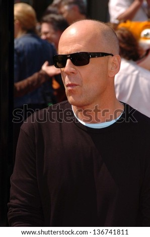 """WESTWOOD - APRIL 30: Bruce Willis at the Los Angeles Premiere of """"Over The Hedge"""" at Mann Village Theatre on April 30, 2006 in Westwood, CA. - stock photo"""