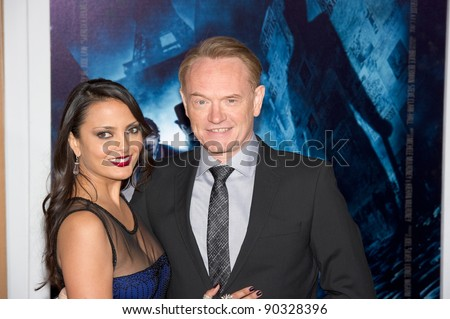 "WESTWOOD, CA - DECEMBER 6: Actor Jared Harris and Allegra Riggio arrive at the premiere of ""Sherlock Holmes 2: A Game of Shadows"" at Regency Village Theater on December 6, 2011 in Westwood, California - stock photo"