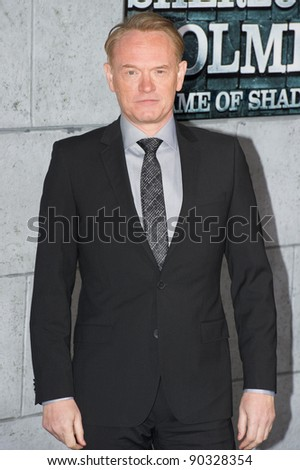 "WESTWOOD, CA - DECEMBER 6: Actor Jared Harris arrives at the premiere of ""Sherlock Holmes 2: A Game of Shadows"" at Regency Village Theater on December 6, 2011 in Westwood, California - stock photo"