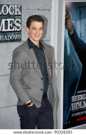 "WESTWOOD, CA - DECEMBER 6: Actor Miles Teller arrives at the premiere of ""Sherlock Holmes 2: A Game of Shadows"" at Regency Village Theater on December 6, 2011 in Westwood, California - stock photo"