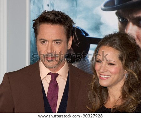 "WESTWOOD, CA - DECEMBER 6: Actor Robert Downey Jr. and producer Susan Downey arrive at the premiere of ""Sherlock Holmes 2 : A Game of Shadows"" on December 6 2011 in Westwood, California - stock photo"