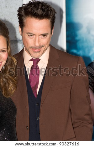 "WESTWOOD, CA - DECEMBER 6: Actor Robert Downey Jr. arrives at the premiere of ""Sherlock Holmes 2: A Game of Shadows"" at Regency Village Theater on December 6, 2011 in Westwood, California - stock photo"