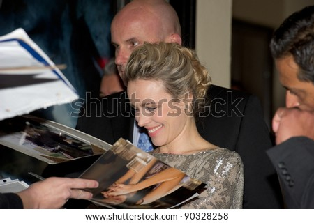 "WESTWOOD, CA - DECEMBER 6: Actress Rachel McAdams signs autographs at the premiere of ""Sherlock Holmes 2: A Game of Shadows"" at Regency Village Theater on December 6, 2011 in Westwood, California - stock photo"