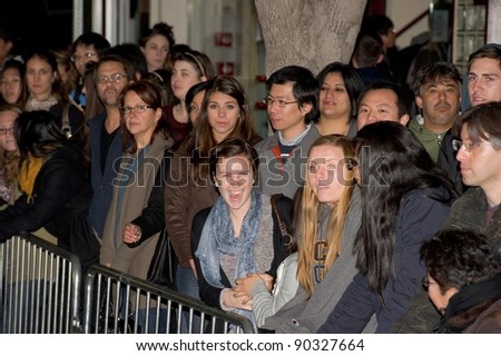 "WESTWOOD, CA - DECEMBER 6: Fans at the premiere of ""Sherlock Holmes 2: A Game of Shadows"" at Regency Village Theater on December 6, 2011 in Westwood, California - stock photo"