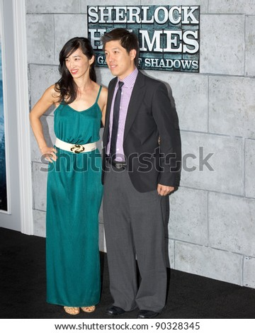 "WESTWOOD, CA - DECEMBER 6: Producer Dan Lin arrives at the premiere of ""Sherlock Holmes 2: A Game of Shadows"" at Regency Village Theater on December 6, 2011 in Westwood, California - stock photo"