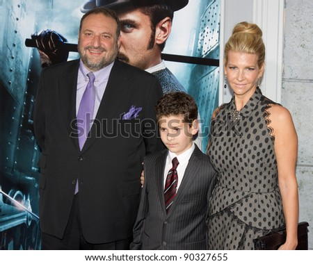 "WESTWOOD, CA - DECEMBER 6: Producer Joel Silver and his family arrive at the premiere of ""Sherlock Holmes 2: A Game of Shadows"" at Regency Village Theater on December 6, 2011 in Westwood, California - stock photo"