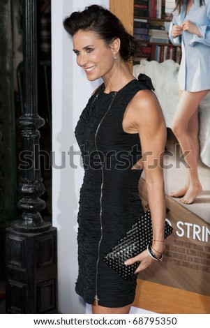 WESTWOOD, CA. - JAN 11: Actress Demi Moore arrives at the Paramount Pictures premiere of No Strings Attached on January 11, 2011 at the Regency Village Theater in Westwood, CA - stock photo