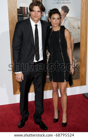 WESTWOOD, CA. - JAN 11: Demi Moore (R) and husband Ashton Kutcher (L)  arrive at the Paramount Pictures premiere of No Strings Attached on January 11, 2011 at the Regency Village Theater in Westwood, CA - stock photo