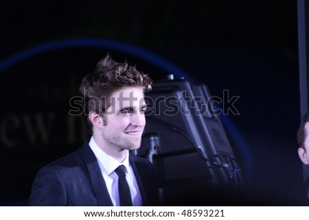 """WESTWOOD, CA - NOVEMBER 16: Actor Robert Pattinson at the premiere of the movie """"Twilight Saga: New Moon""""at Regency's Village Theatre   November 16, 2009 in Westwood, CA. - stock photo"""