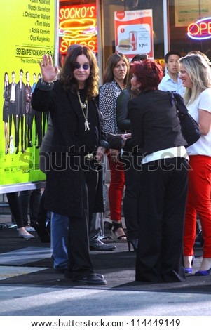 "WESTWOOD CA - OCTOBER 1: Rocker Ozzie (and Sharon(r)) Osbourne waves to fans for fan photo at ""Seven Psychopaths"" premiere at Bruin Theatre October 1, 2012 Westwood, CA - stock photo"