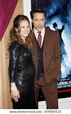 "WESTWOOD, CALIFORNIA - December 6, 2011. Robert Downey Jr. and Susan Downey at the Los Angeles premiere of ""Sherlock Holmes: A Game Of Shadows"" held at the Regency Village Theatre, Los Angeles."