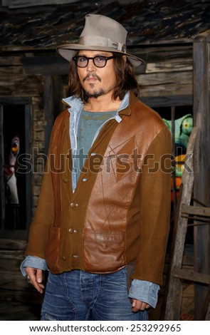 """WESTWOOD, CALIFORNIA - Monday February 14, 2011. Johnny Depp at the Los Angeles premiere of """"Rango"""" held at the Regency Village Theatre, Los Angeles.  - stock photo"""