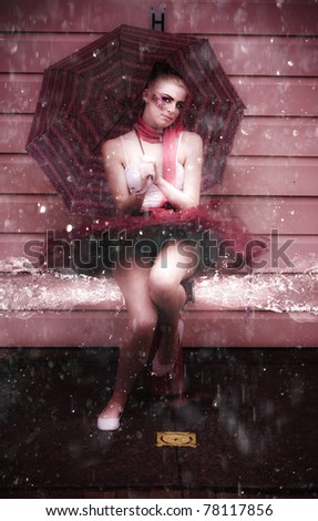 Wet Action Shot Of A Ballerina In Leotard Sitting On A Fire Hydrant Gushing Splashing And Spraying Water Droplets In A Beautiful And Elegant Splash Dancing Pic - stock photo