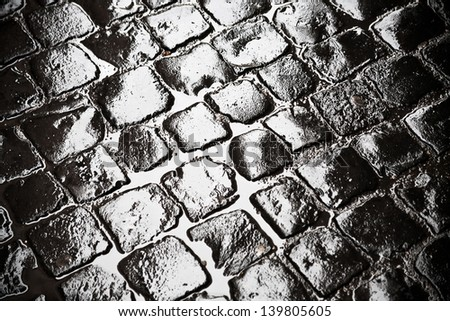 wet ancient cobblestones on old Rome city road - stock photo