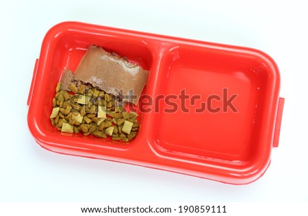 Wet and Dry for cat or dog treats in red bowl isolated on white - stock photo