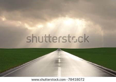 wet asphalt road after a rain - stock photo