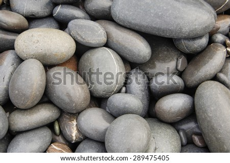 Wet beach pebbles background - stock photo