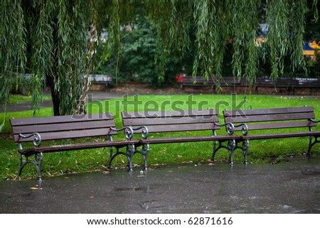 wet benches in the park on rain - stock photo