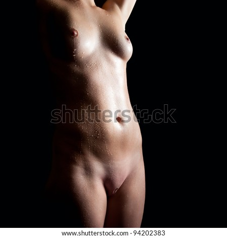 Wet body of a beautiful naked woman, closeup in front of black background - stock photo